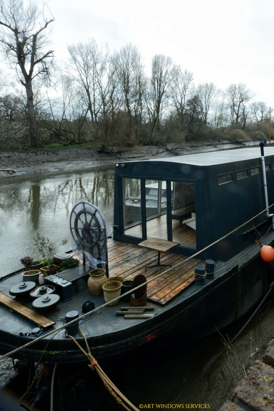 A boathouse on the River Thames aluminium sliding door aluminium door