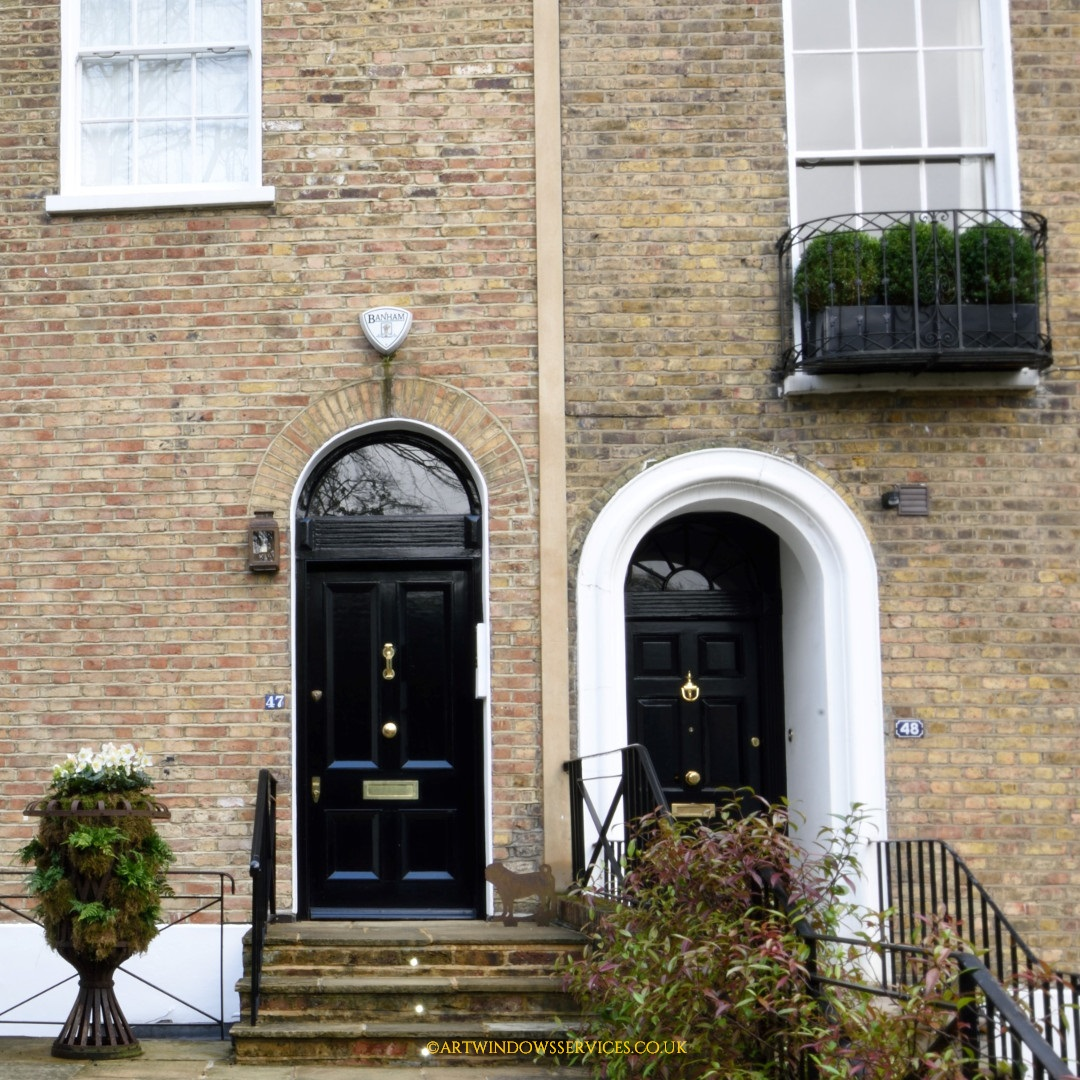 Black timber entry door residential area Notting Hill
